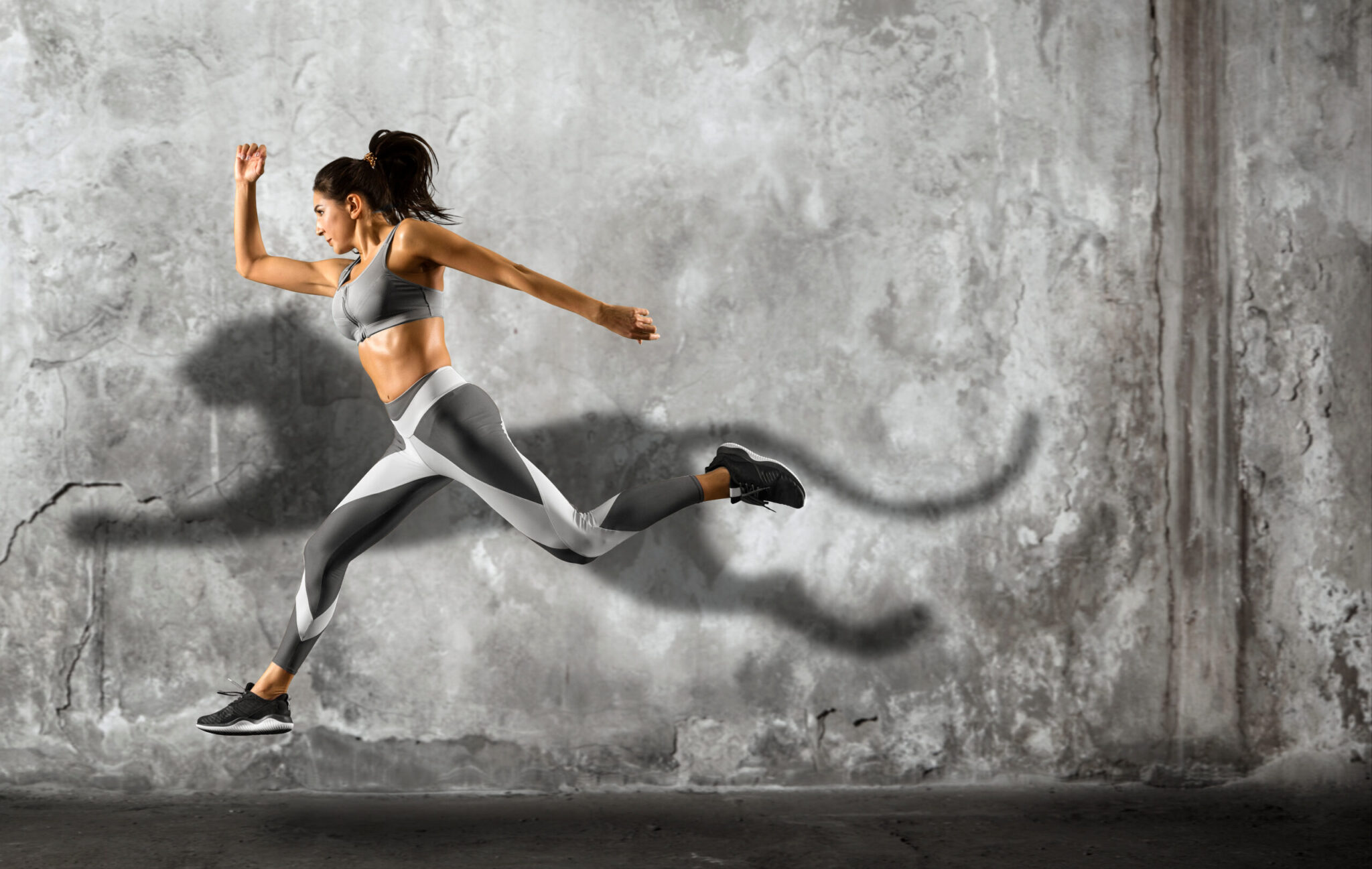 Sporty Young Woman Running